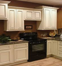 painted kitchen cabinets vintage cream: wonderful wooden antique white cabinets as kitchen cabinetry set with grey granite countertops and black modern