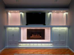 led entertainment center and fireplace accent lighting traditional family room accent lighting family room
