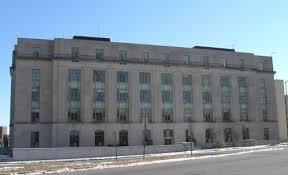 the huge office building constructed of indiana limestone has flat classical detailing influenced by the art deco style art deco office building