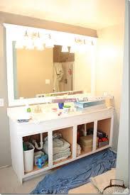 framing a large bathroom mirror 23 bathroom lighting and mirrors
