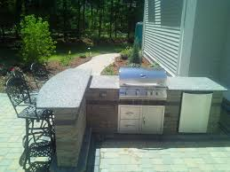 patio outdoor stone kitchen bar:  images about outdoor kitchens on pinterest design trends bar and brother