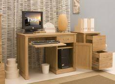 the baumhaus mobel oak single pedestal computer desk is a discreet and highly functional storage solution baumhaus mobel oak hidden home office