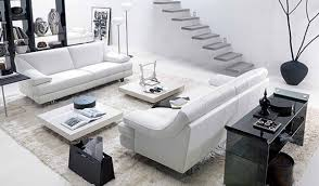living room furniture miami: living room tables nearby modern leather sofa behind glass console