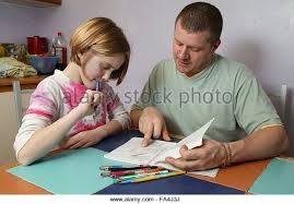 Parents Helping Children Homework In Stock Photos  amp  Parents     Alamy Single parent helping young daughter with her homework in the kitchen    Stock Image
