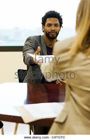 Cv Resume Stock Photos  amp  Cv Resume Stock Images   Alamy Man handing prospective employer his resume during job interview   Stock Image