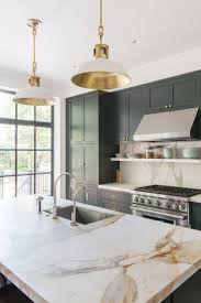 calacatta marble kitchen waterfall: we like the kitchen that we have now at oceana but we would like the island to be calcutta gold marble along with the backsplash which we think would go