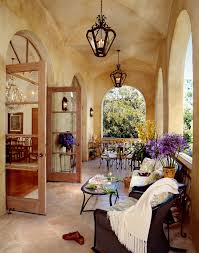 large lantern patio mediterranean with arched window stone balustrade arched window apothecary style furniture patio mediterranean