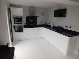 kitchen worktops ideas worktop full: this monochrome kitchen is ultra sleek with handleless white gloss units and black worktops the