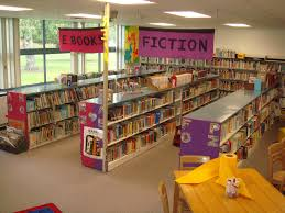 best ideas about elementary school library elementary library decoration themes shelving was organized in long runs and identified