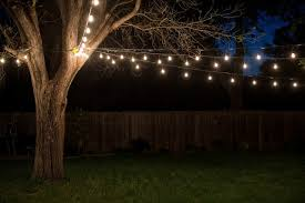 garden design with putting up industrial vintage string lights in the backyard this with raised garden backyard string lighting