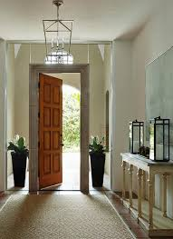 doors sidelights open a red  panel front door flanked by seamless glass floor to cieling sid