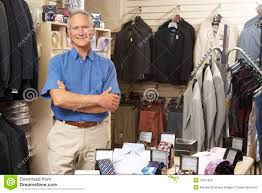 male s assistant in clothing store royalty stock images male s assistant in clothing store