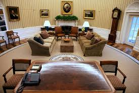 the oval office on tuesday gone are the gold and yellow tones and the sunburst rug the desk and the grandfather clock are the same bill clinton oval office rug