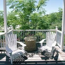 balcony gestalten tree chairs table small braided balcony design furniture