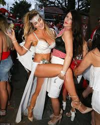 Londons annual boozy Santacon sees thousands of revellers don. Meanwhile in Australia. One particularly well dressed woman is seen with a