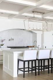 california beach house with crisp white coastal interiors kitchen lighting beach house kitchen nickel oversized pendant