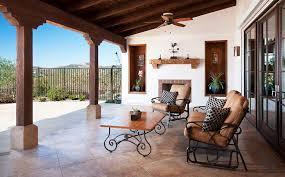 outdoor corridor patio mediterranean with dark brown door trim stucco exterior brown covers outdoor patio