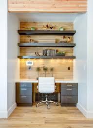 the elwood skye estates trendy home office photo in salt lake city with medium tone hardwood built office desk