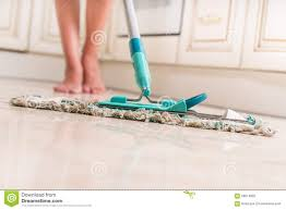 cleaning kitchen floor stock photo