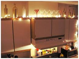 lighting and ivy above kitchen cabinets above kitchen cabinet lighting