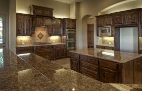 lights above cabinets and pretty tile work around backsplash above cabinet lighting