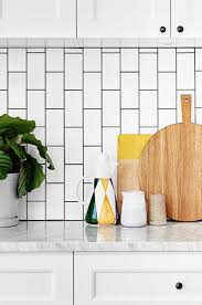 subway tiles tile site largest selection: a marble kitchen benchtop sits well with a budget friendly choice of vinyl wrap polytec