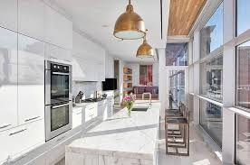building kitchen cabinets filled light filled modern kitchen with floor to ceiling windows and a double