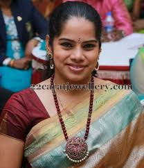 Tamil Actress Deepa Venkat graced Raindrops 2nd Annual Women Achiever Awards 2014 event in Chennai. She wears pear shaped glass cut large ruby beads and ... - deepa-venkat-beads-long-chain