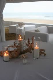 coral beach wedding centerpieces driftwood coral centerpiece sandbridge virginia beach isha foss events beach theme lighting