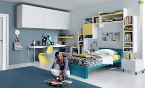 teenage girl bedroom ideas blue wall color white furniture yellow accents blue and white furniture
