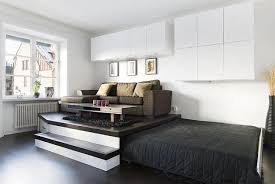 storage solutions living room: practical storage solution in the living room of a small apartment hidden bed in the