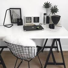 white desk w black hairpin legs black wire chair w white pillow or throw home office room calmly
