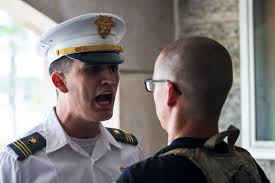 u s department of defense photo essay a third year cadet left corrects a new cadet s reporting statement at west
