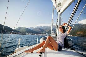 <b>long hair girl</b> on yacht in Montenegro Stock Photo