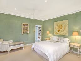 colours for a bedroom: asian inspired bedroom design idea with wallpaper amp bi fold doors using beige colours