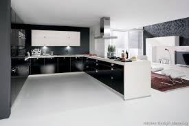 kitchen modern cabinets designs: a black and white kitchen with contemporary cabinets