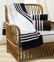 art deco towel by ralph lauren looks great hanging over this classic rattan chair pinned art deco outdoor furniture