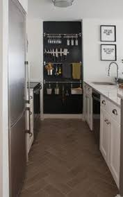 kitchen floor tiles small space: make the most of limited kitchen space by mounting rows of racks on the wall from floor to ceiling drape towels over a bar use s hooks to hang kitchen