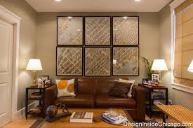 a leather couch and coffee table with a series of vintage maps from manhattan ne traditional chicago home office