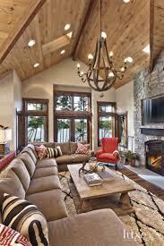 the restoration hardware chandelier made of wine barrels and the custom shag rug encapsulate a rustic charm impression living room lighting ideas