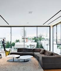 the living room features stunning views of the city a bend sofa and phoenix coffee bb italy furniture