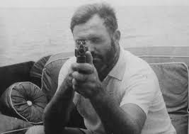 ernie me a ier falls in and falls out hemingway hemingway a tommy gun aboard his yacht the pilar in 1935