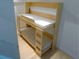 dumbo double tuck bed packs two folding beds into one wall unit inhabitots bunk bed steps casa kids