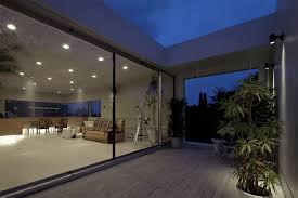 architecture modern open balcony design with glass sliding door laminate flooring tile and indoor plants architects sliding door office
