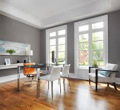 here we have a large open office with warm grey walls white paneling and white furniture which adds a nice accent to the panels best office paint colors