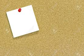 a blank memo or sticky note tacked to a cork notice board a blank memo or sticky note tacked to a cork notice board copyspace stock