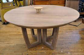 expanding dining table a round expanding dining table with a leaf