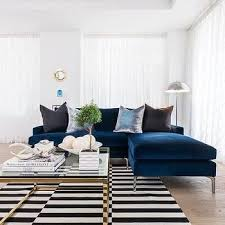 blue sofas living room: sapphire blue velvet sofa with chaise lounge and black and white striped rug middot secret living roomcozy
