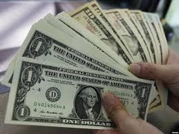 طهران - إيران توقف التعامل بالدولار الأمريكي