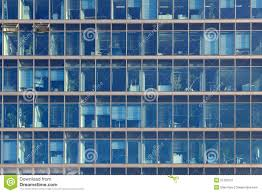 glimpse into the workplaces of an office building with blue glas building an office